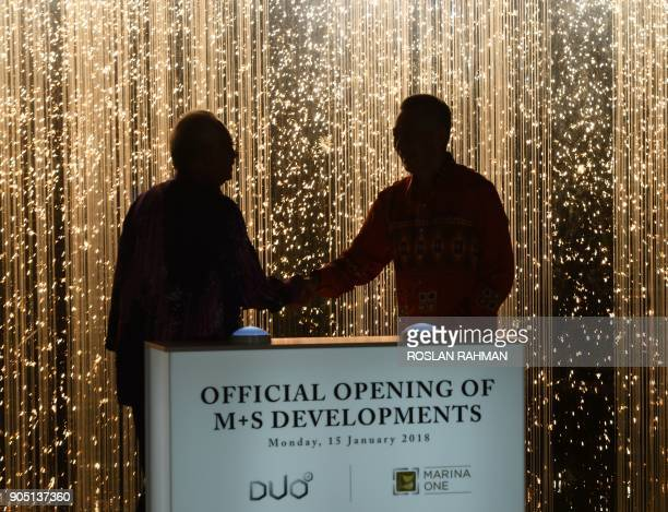 Malaysia Prime Minister Najib Razak and Singaporean counterpart Lee Hsien Loong attend the official opening of Marina One and DUO at the two mixed...