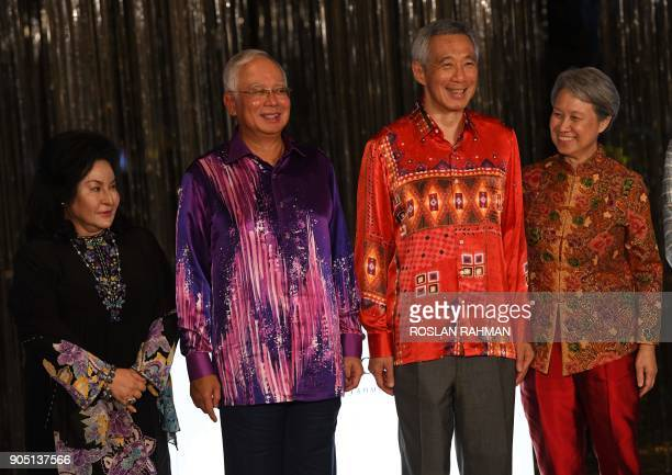 Malaysia Prime Minister Najib Razak his wife Rosmah Mansor his Singaporean counterpart Lee Hsien Loong and Lee attend the official opening of Marina...