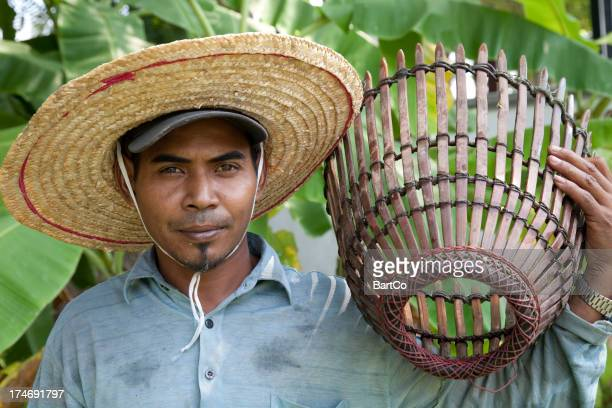 Malaysia, working at a rice paddy.