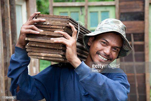 malaysia, working with tools and building activity. - malaysia stock pictures, royalty-free photos & images