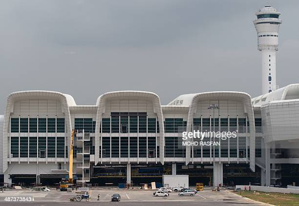 MalaysiaaviationinfrastructurebudgetFOCUS by M This picture taken on April 12 2014 shows workers at the under construction lowcost carrier terminal...