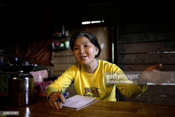 MalaysiaBorneoPenanpoliticsFEATURE by M Jegathesan This picture taken on July 21 2010 shows 60year old Ganiet Nyato of Malaysia's Penan tribe telling...