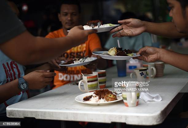 Malaysiafoodlifestylecuisine FEATURE by Satish Cheney In this picture taken March 25 2015 a waiter serves the popular Nasi Lemak dish to waiting...