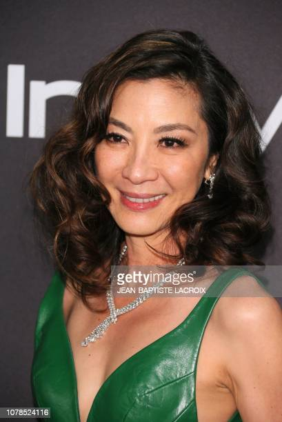 Malaysian actress Michelle Yeoh arrives for the Warner Bros and In Style 20th annual post Golden Globes party at the Oasis Courtyard of the Beverly...
