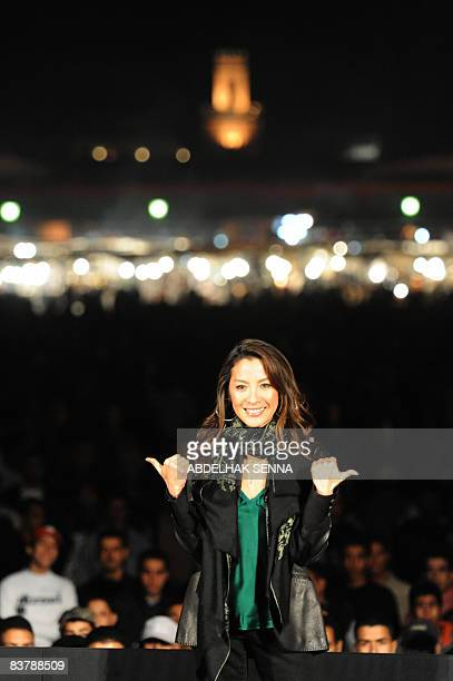 Malaysian actress Michelle Yeoh poses as she arrives for an open air screening of Crouching Tiger Hidden Dragon during the 8th International...
