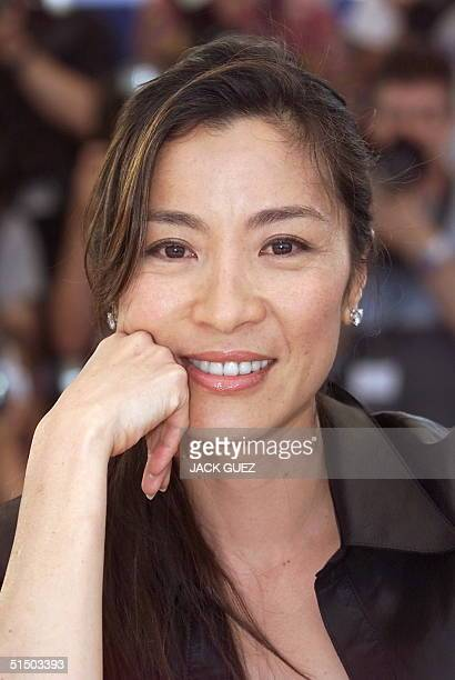 Malaysian actress Michelle Yeoh poses during the photocall of Taiwanese director Ang Lee movie Crouching Tiger Hidden Dragon 19 May 2000 in Cannes...