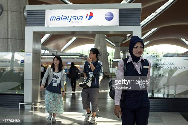 A Malaysian Airline System Bhd flight attendant leaves the airline's first class checkin area at Kuala Lumpur International Airport in Sepang...