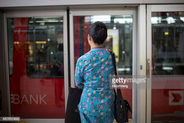 A Malaysian Airline Systems Bhd flight attendant stands at a train platform at Kuala Lumpur International Airport in Sepang Malaysia on Tuesday July...