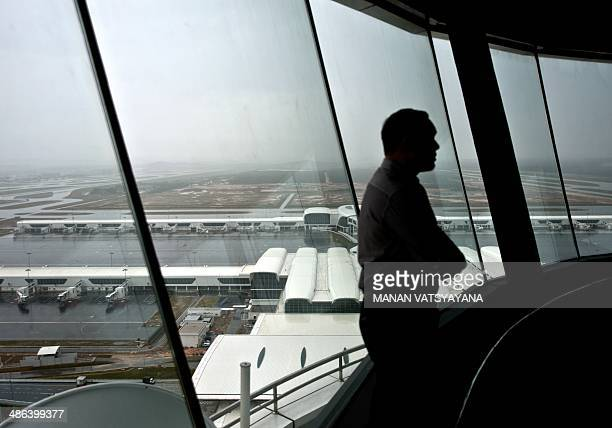 A Malaysian airport employee stands inside the new air traffic control tower at the soontobe inaugrated lowcost carrier terminal at Kuala Lumpur...