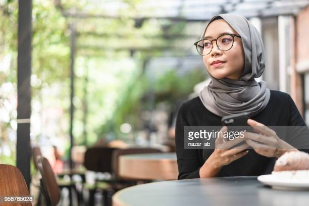 Malaysian ambitious businesswoman with smartphone in her hand.