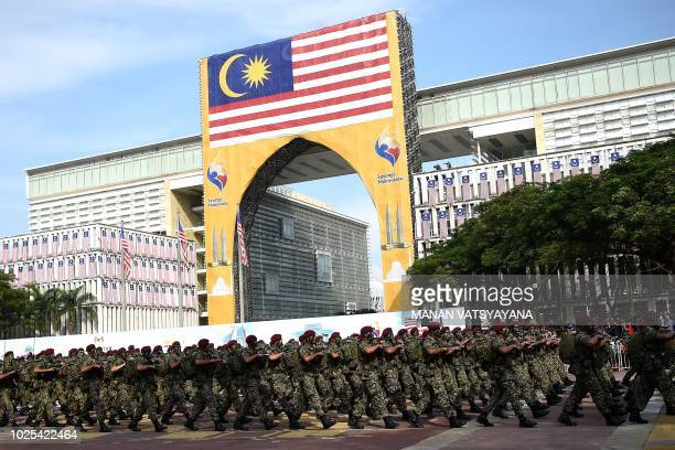 Malaysian Armed Forces personnel march during the National Day celebration parade in Putrajaya on the outskirts of Kuala Lumpur on August 31 2018