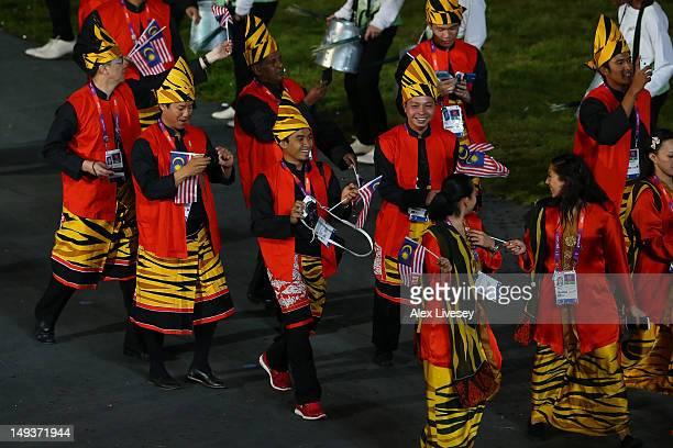 Malaysian athletes parade during the Opening Ceremony of the London 2012 Olympic Games at the Olympic Stadium on July 27 2012 in London England