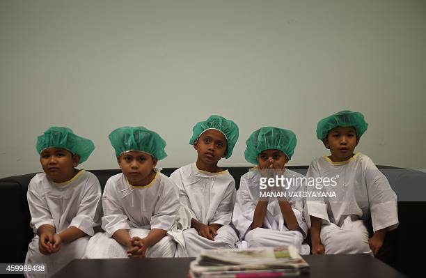 Malaysian boys wait for their turn during a masscircumcision ceremony at the Tuanku Mizan Army hospital in Kuala Lumpur on December 5 2014 112...