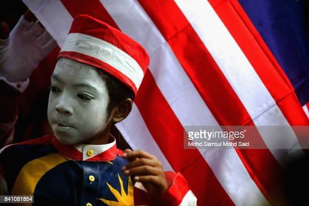 Malaysian child has his face painted during the 60th Merdeka Day celebrations at Merdeka Square on August 31 2017 in Kuala Lumpur Malaysia Hari...