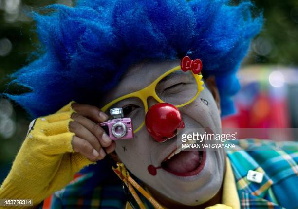 Malaysian clown Mohd Bukhari aka Mr JAJA gestures during a Clown Festival in Kuala Lumpur on August 17 2014 Around 80 clowns from all over Malaysia...