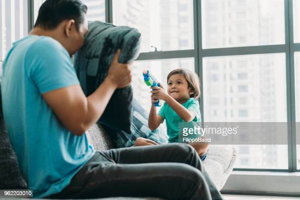 Malaysian dad playing with his child