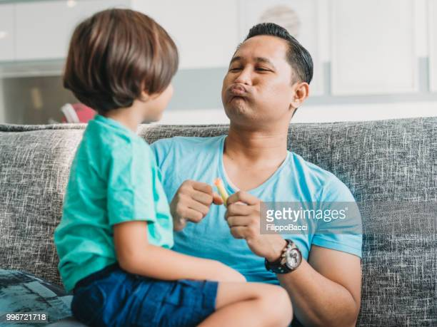 malaysian dad playing with his child - crazy dad stock photos and pictures