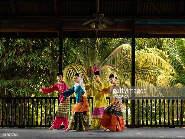 a malaysian dance troupe. - dance troupe stock photos and pictures