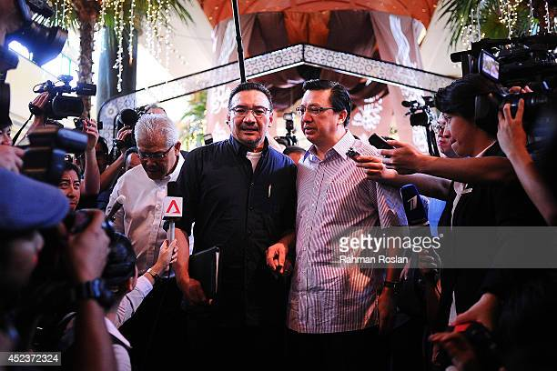 Malaysian Defense Minister Hishammuddin Hussein and Transport Minister Liow Tiong Lai address the members of media on July 19 2014 in Kuala Lumpur...