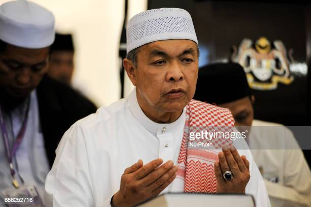 Malaysian Deputy Prime Minister and Home Minister Ahmad Zahid Hamidi offers prayers inside the Federal Territory Mosque during the gathering for...