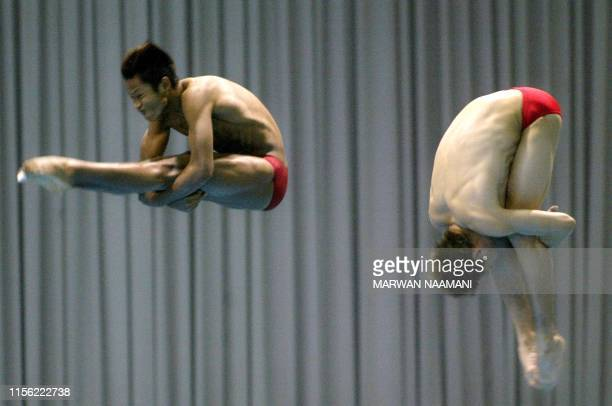 Malaysian divers Ken Nee Yeoh and Roslan Rossharisham perform in the final of the men's 3m sychronized dive event 09 October 2002 at Sajik pool in...