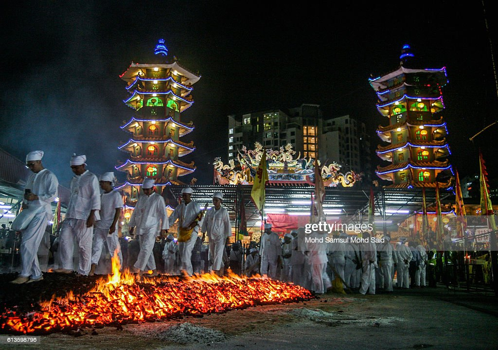 Malaysian ethnic Chinese walk on burning charcoals during the Chinese Nine Emperor Gods Festival on October 9, 2016 in Kuala Lumpur, Malaysia. The Nine Emperor Gods Festival welcomes the emperor gods that live in the stars under the reign of 'Thien Hou' or the 'Queen of Heaven' who brings good fortune, longevity and good health. Some devotees stay at a temple during the nine-day Taoist celebration, beginning on the eve of the ninth lunar month of the Chinese calendar, consume vegetarian meals and recite continuous prayers.
