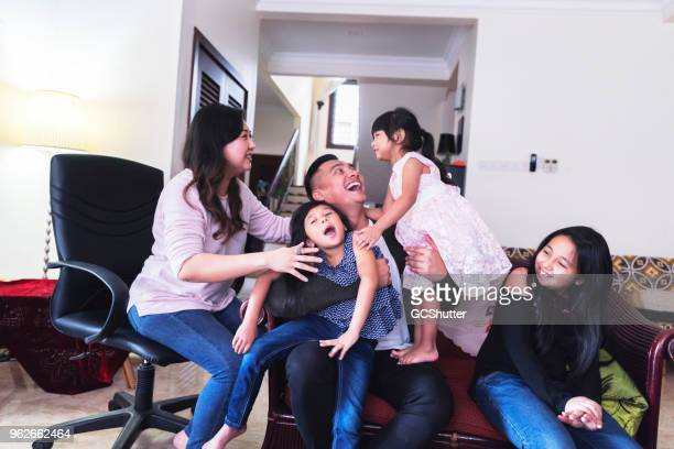 malaysian family at home - family at home stock photos and pictures