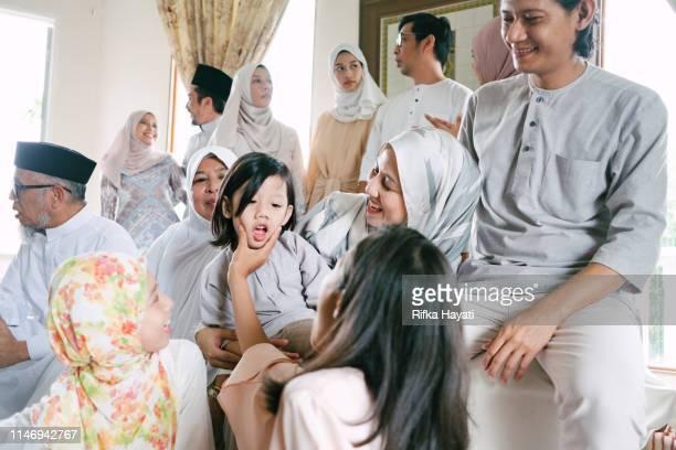 malaysian family celebrating hari raya eid mubarak at home - eid ul fitr photos stock pictures, royalty-free photos & images