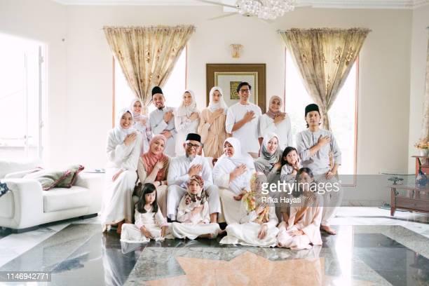 malaysian family celebrating hari raya eid mubarak at home - hari raya celebration stock pictures, royalty-free photos & images