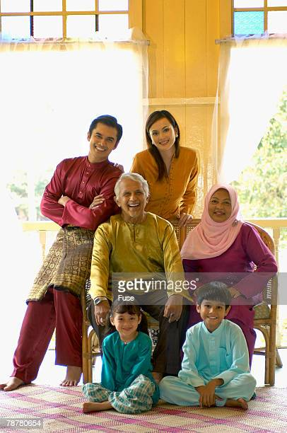 malaysian family - hari raya stock pictures, royalty-free photos & images