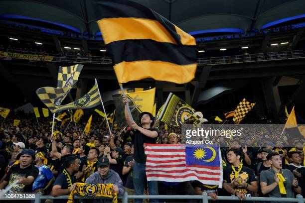 Malaysian fans cheer during the 2018 AFF Suzuki Cup Group A match between Malaysia and Myanmar at the Bukit Jalil National Stadium on November 24,...