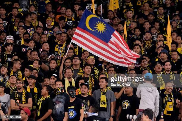 Malaysian fans cheer during the AFF Suzuki Cup final first leg match between Malaysia and Vietnam at Bukit Jalil National Stadium on December 11,...