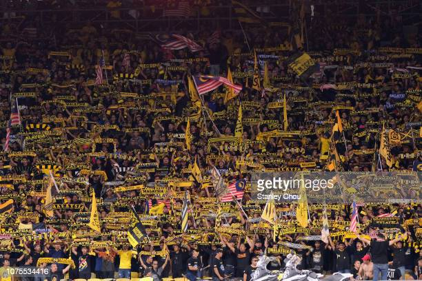 Malaysian fans cheer during the AFF Suzuki Cup semi final between Malaysia and Thailand at Bukit Jalil National Stadium on December 01, 2018 in Kuala...