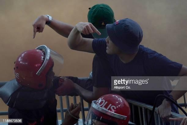 Malaysian fans clash with security personnel after their team scored against Indonesia 10 during the 2022 Qatar FIFA World Cup Asian qualifier group...