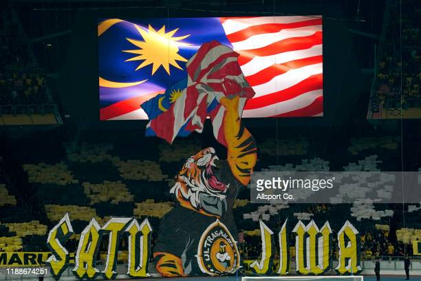 Malaysian fans display their mascot of a Tiger during the 2022 Qatar FIFA World Cup Asian qualifier group G match between Malaysia and Indonesia at...