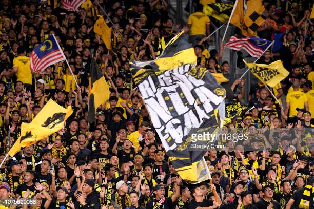 Malaysian fans during the AFF Suzuki Cup semi final between Malaysia and Thailand at Bukit Jalil National Stadium on December 01, 2018 in Kuala...