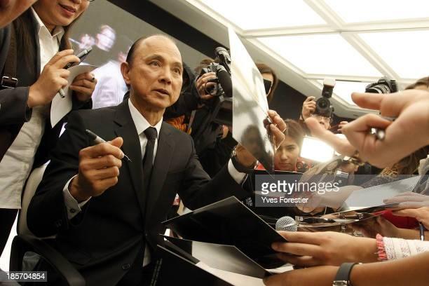 Malaysian fashion designer Jimmy Choo signs autographs after his workshop at Center Of National Arts on October 23, 2013 in Tashkent, Uzbekistan.