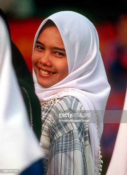 Malaysian females wearing batik dress and chadors Malaysia