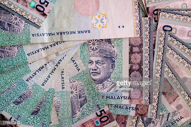 Malaysian fifty ringgit banknotes are arranged for a photograph in Kuala Lumpur Malaysia on Monday Sept 2 2013 Malaysias ringgit dropped the most in...