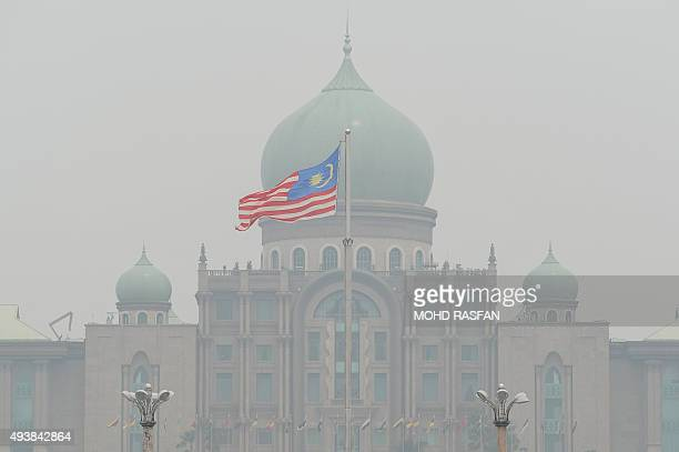 A Malaysian flag flutters in front of the prime minister's office in Putrajaya on October 23 2015 Fires raging across huge areas of Indonesia are...