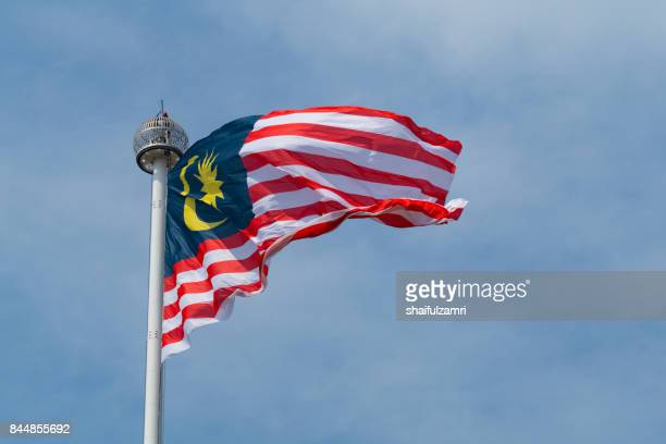 """malaysian flag or """"jalur gemilang"""" for celebrating the 60th anniversary of independence day in kuala lumpur, malaysia. - shaifulzamri stock pictures, royalty-free photos & images"""