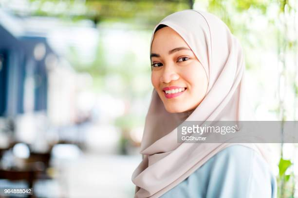 portrait of a beautiful hijabi malaysian girl - malaysia beautiful girl stock photos and pictures