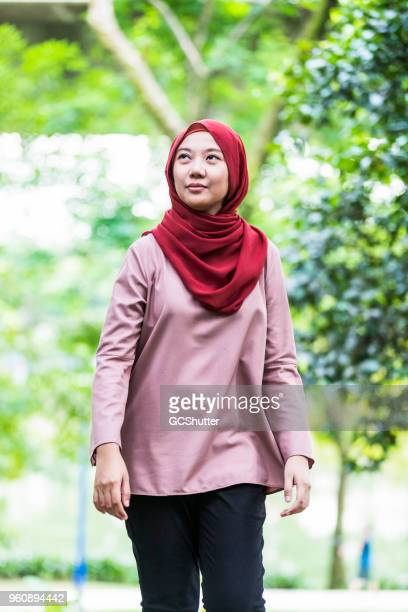malaysian girl wearing hijab, exploring local park - malaysia beautiful girl stock photos and pictures