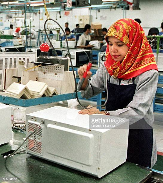 Malaysian girl working on the production line at the Samsung microwave oven plant in Port Klang 02 July Samsung Electronics the only microwave oven...