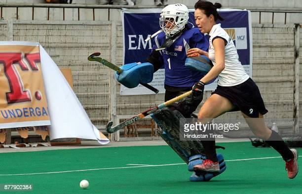Malaysian goal keeper Yahya Farh Ayuni and Azerbaijan player Mammadova Zhun in action during Lal Bahadur Shastri four nation hockey tournament at...