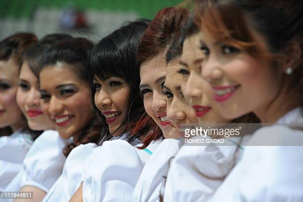 Malaysian grid girls pose at a photo session prior to the start of Formula One's Malaysian Grand Prix at Sepang on April 10 2011 AFP PHOTO / ROMEO...