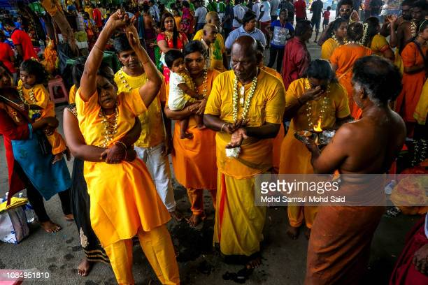 Malaysian Hindu devotees perform a prayer at Batu Caves temple during Thaipusam festivals on January 19 2019 outside Kuala Lumpur Malaysia Thaipusam...