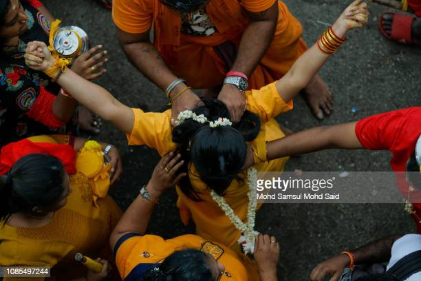 Malaysian Hindu devotees perform a prayer at Batu Caves temple during Thaipusam festivals on January 20 2019 outside Kuala Lumpur Malaysia Thaipusam...