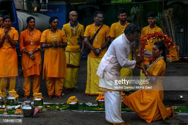 Malaysian Hindu devotees perform a prayer before their pilgrimage to the sacred Batu Caves temple during Thaipusam festivals on January 19 2019...