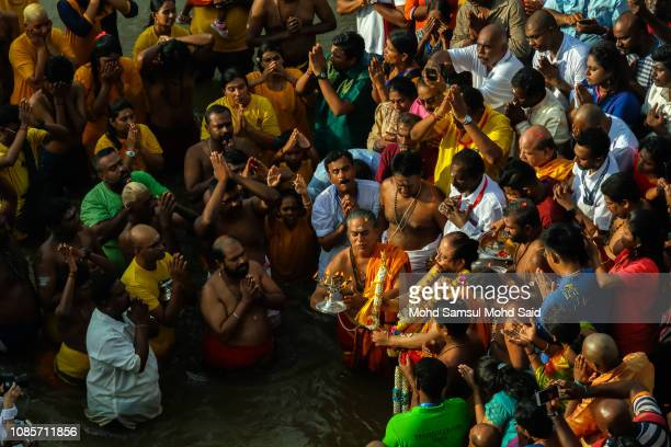 Malaysian Hindu devotees perform a ritual bath in a river before their pilgrimage to the sacred Batu Caves temple during Thaipusam festivals on...